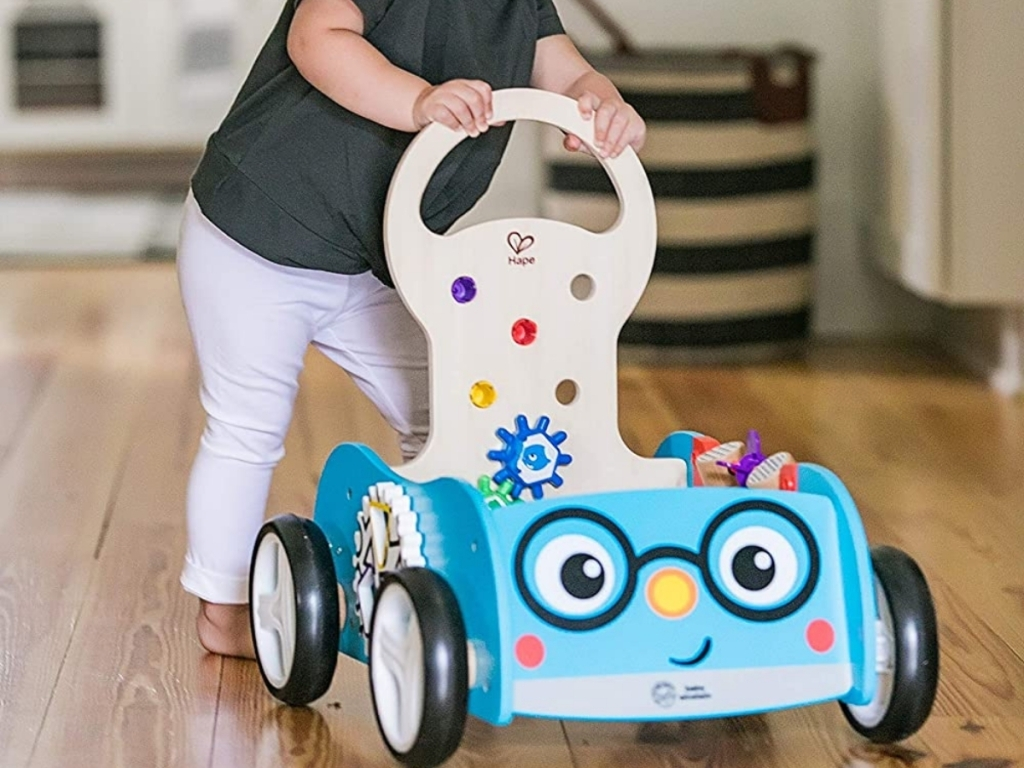 girl walking with baby einstein discovery buggy