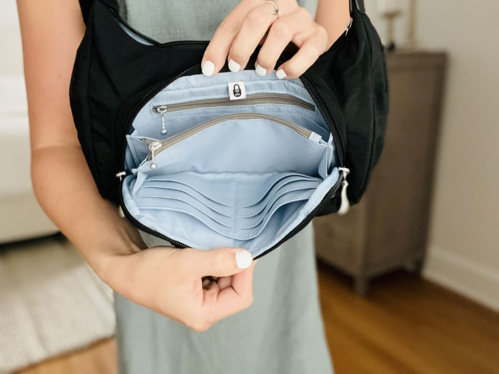 woman holding open a purse