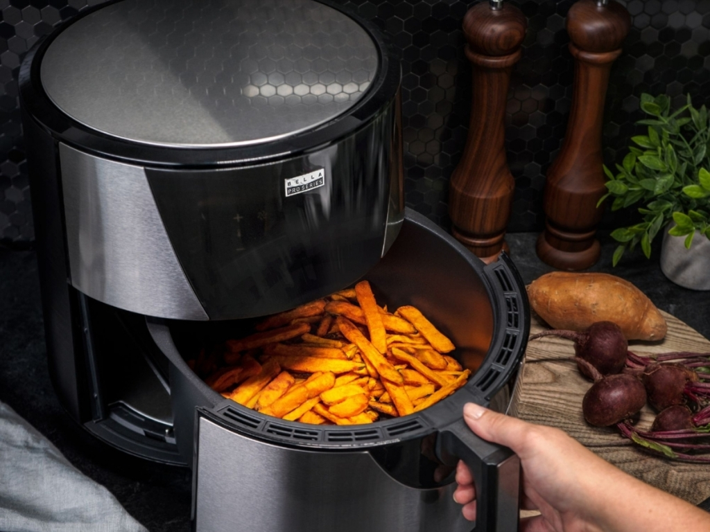bella pro series touchscreen air fryer with food inside