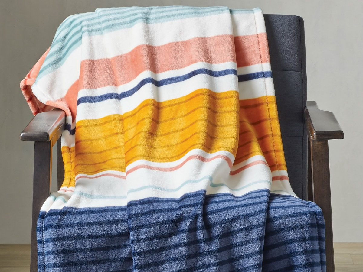 plush striped throw blanket draped over a chair