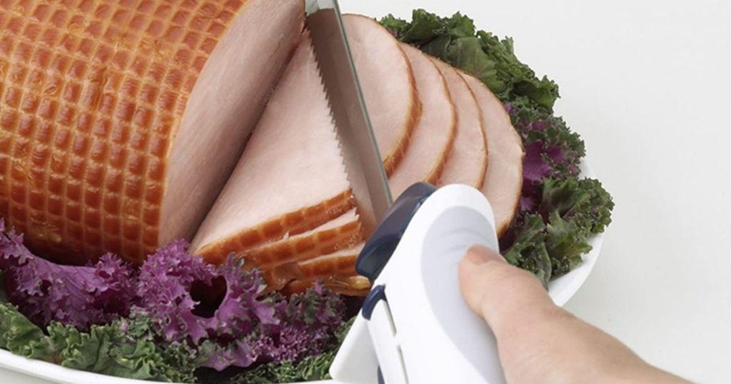 knife cutting a ham
