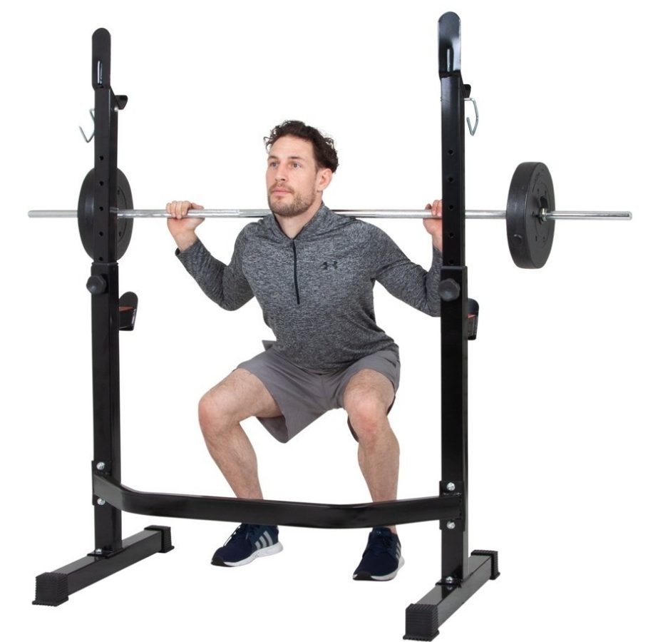 man squatting with body champ weight bench