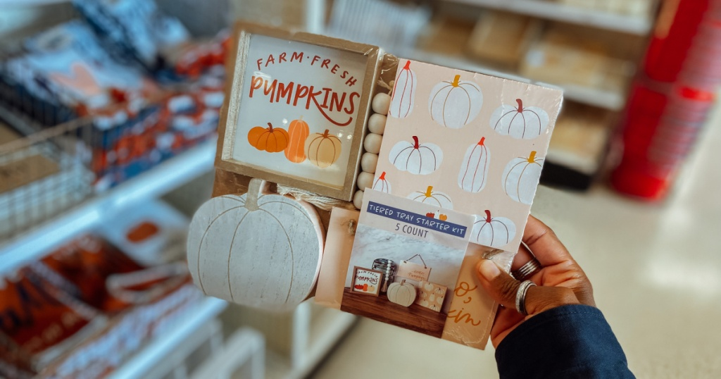 Woman holding Fall Decoration Kit inside Target store