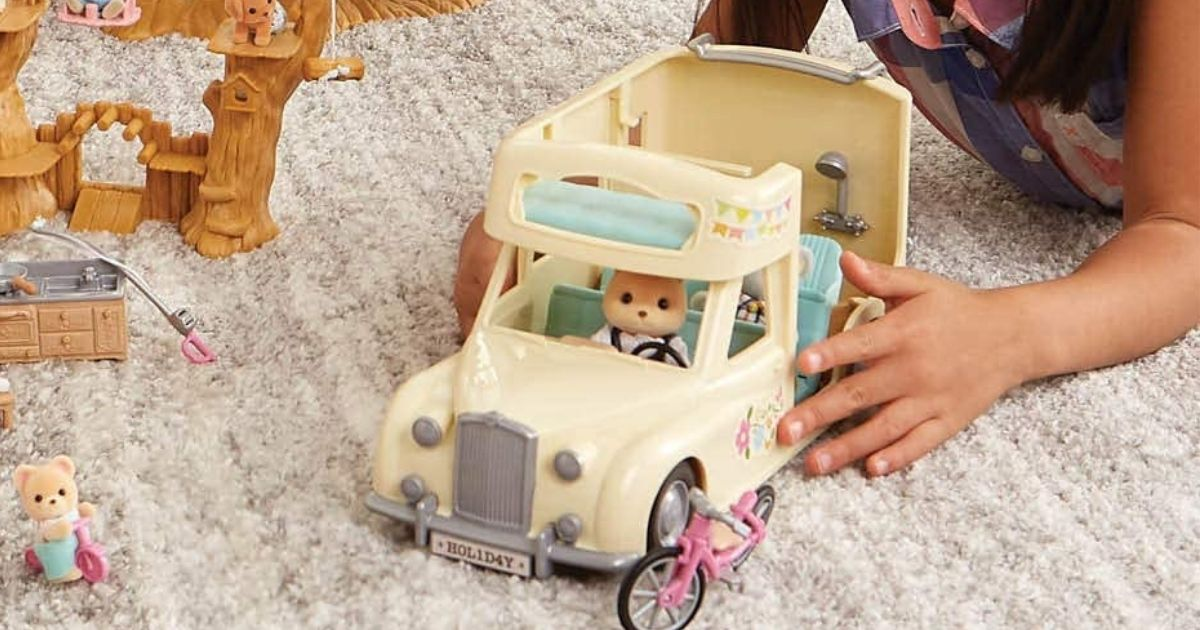 kid playing with Calico Critter Campervan