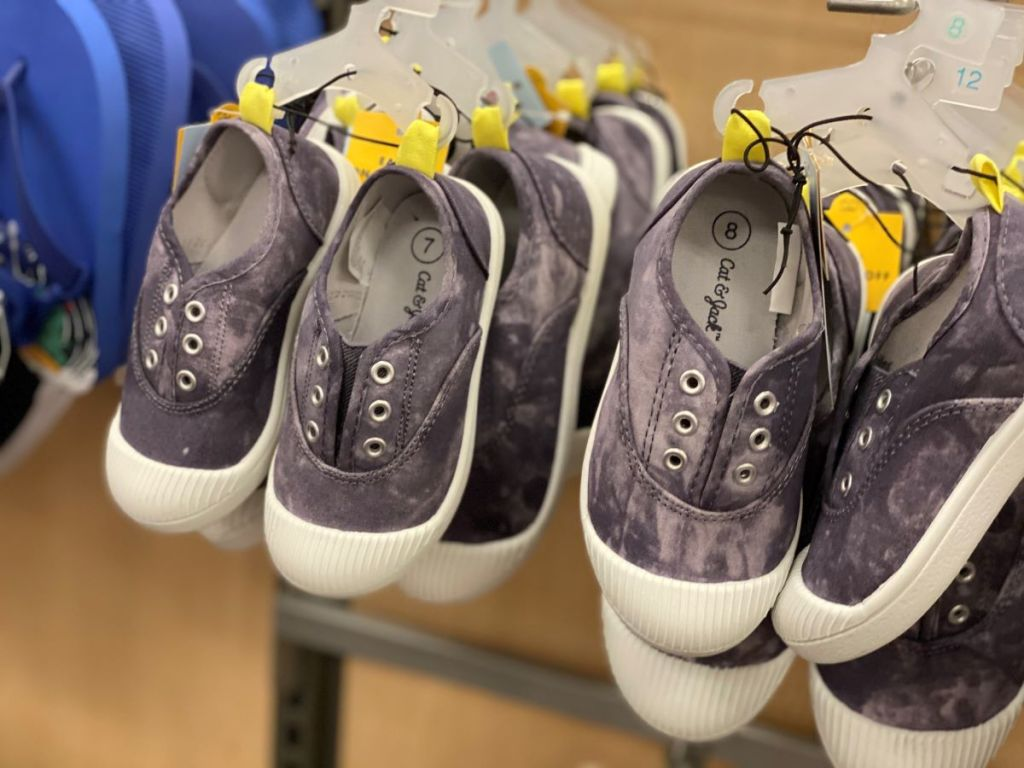 row of kids shoes on hangers