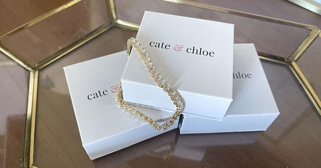diamond bracelet draped over Cate & Chloe boxes