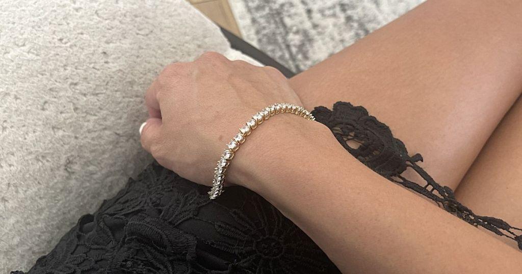 woman wearing diamond bracelet