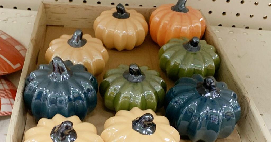 colorful Ceramic Pumpkins on shelf