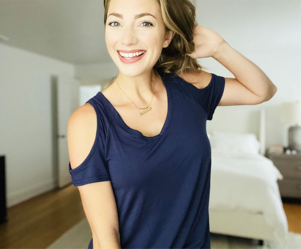 woman wearing blue cold shoulder tunic top