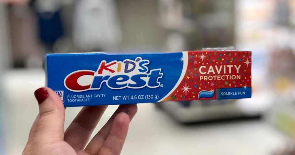 hand holding Crest Kids Cavity Protection Sparkle Fun