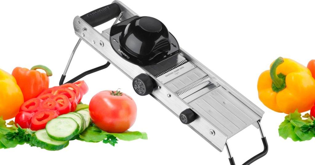 stainless steel mandoline slicer with veggies near it
