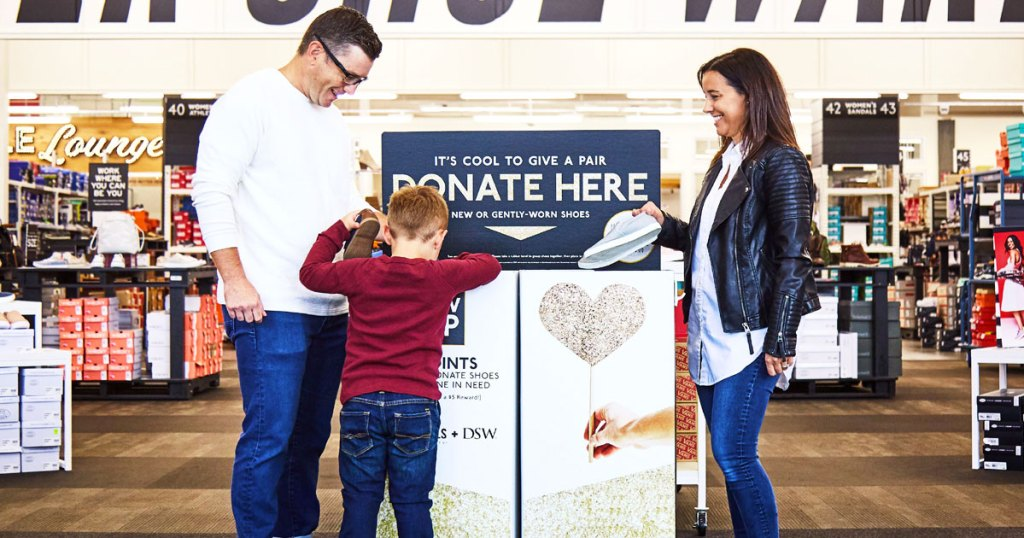 family donating shoes at DSW