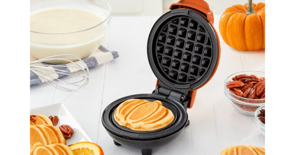 Dash Pumpkin Waffle Maker on counter with waffle inside