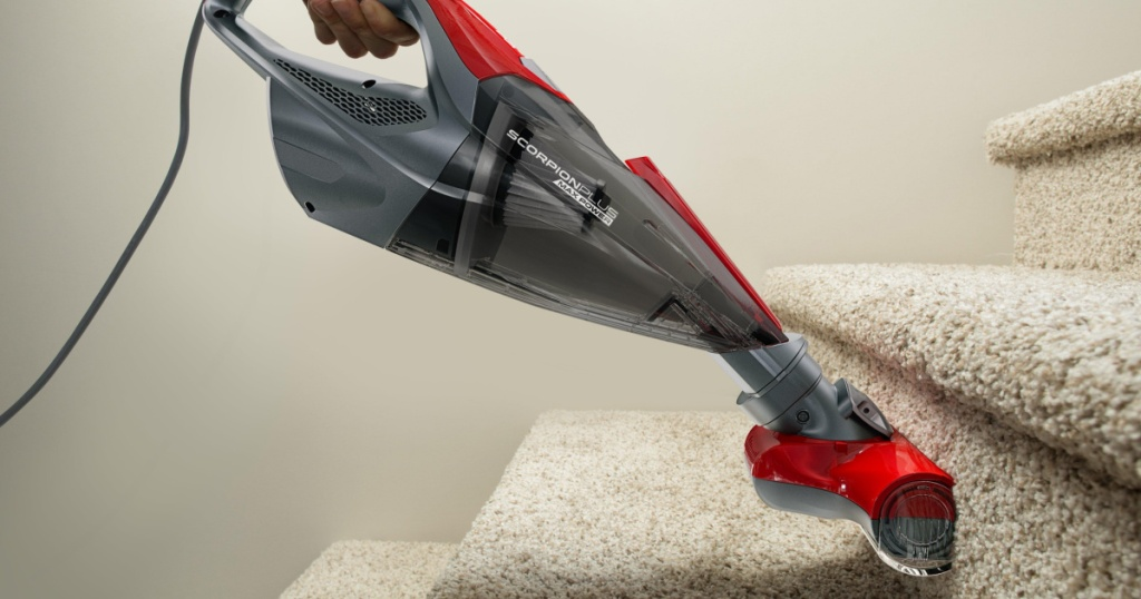 gray and red vaccum on stairs