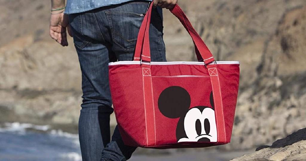 man carrying Disney Cooler