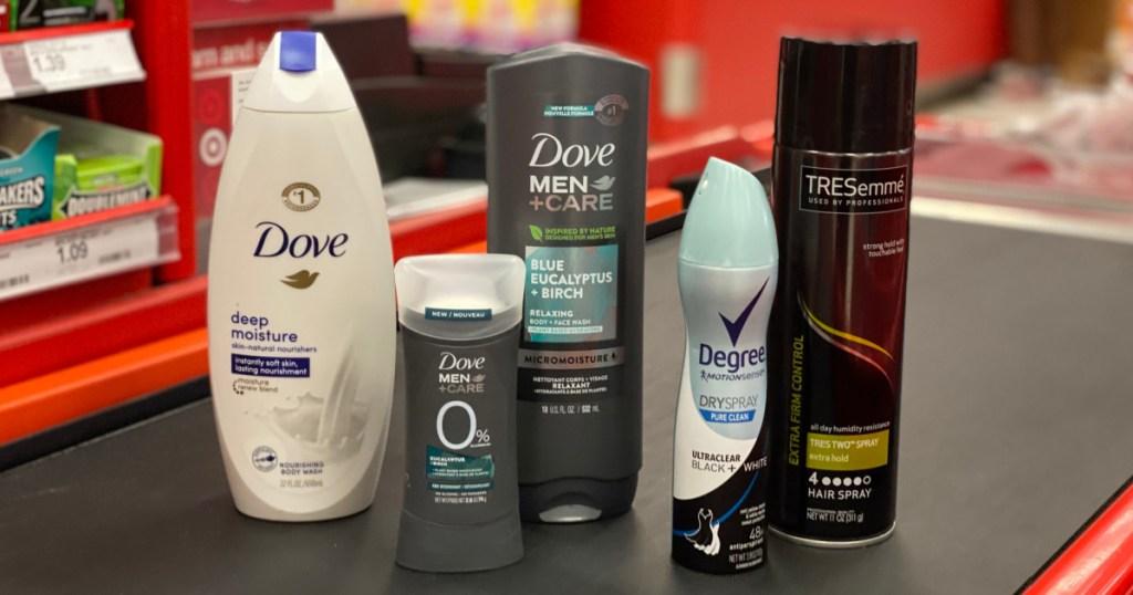 body wash, deodorant and hair spray on conveyor belt