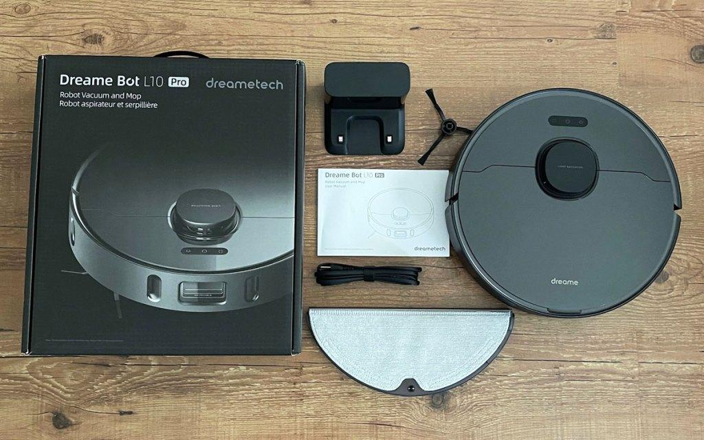 black robotic vacuum with accessories