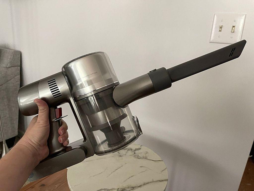 hand holding handheld vacuum