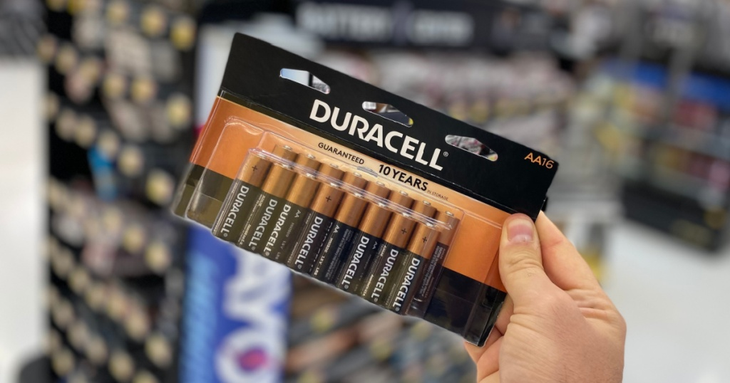 hand holding pack of AA batteries in store