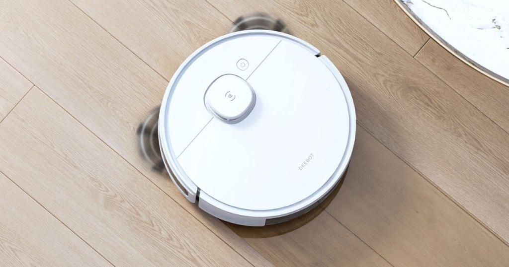 white robotic vacuum on wood floor