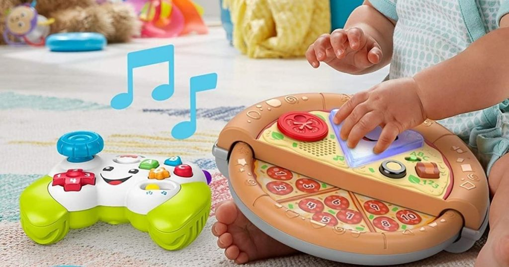 baby playing with a Fisher-Price Pizza and Controller