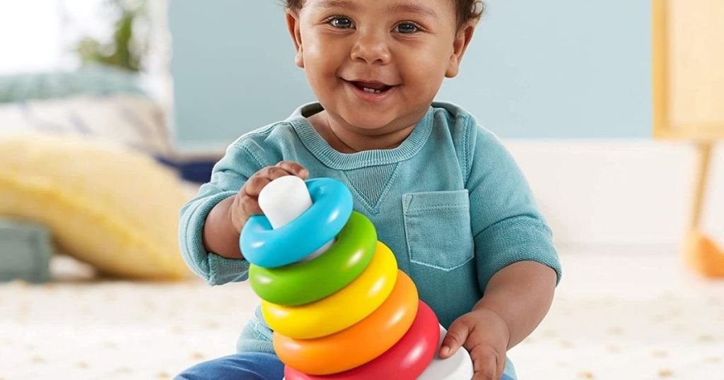 baby holding a Fisher-Price Rock a Stack