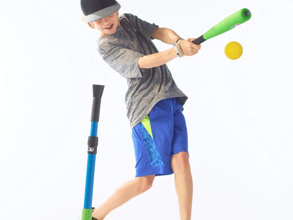 boy hitting a ball off a franklin tee