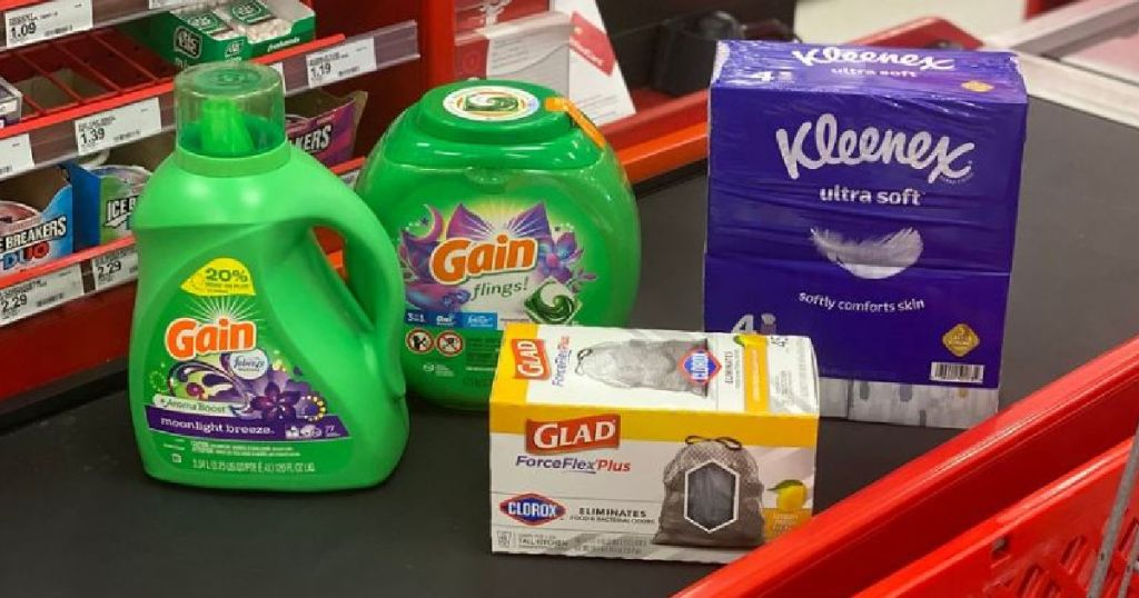 laundry detergent, trash bags and tissues on counter