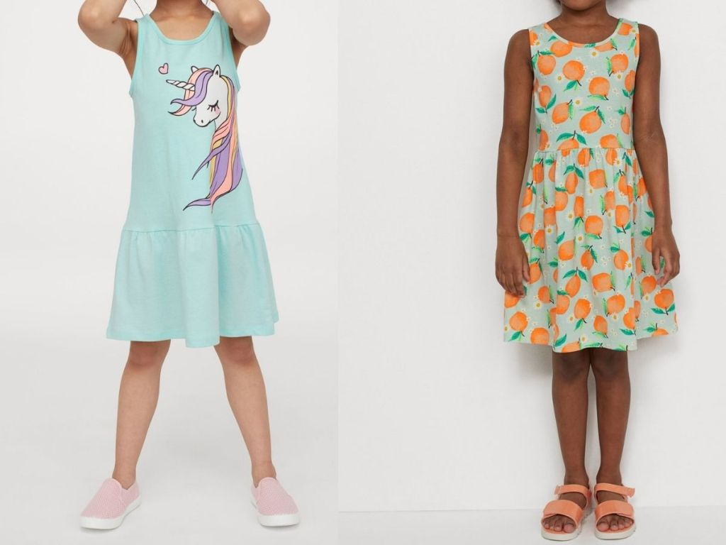 girls wearing unicorn and oranges dresses