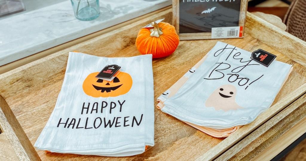 Halloween themed towels on display near Halloween sign