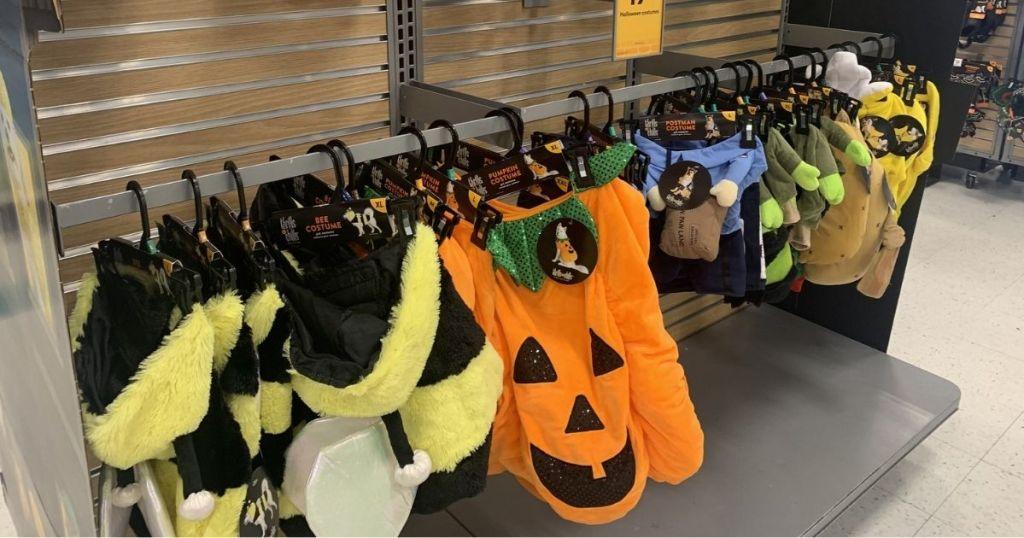 Halloween pet costumes hanging in store