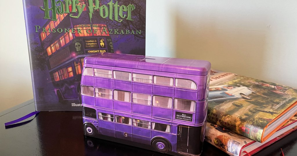 harry potter bus tin in front of harry potter books