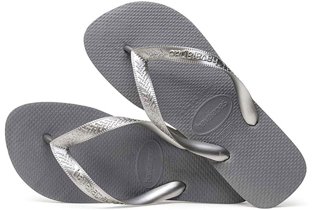 pair of silver flip flops