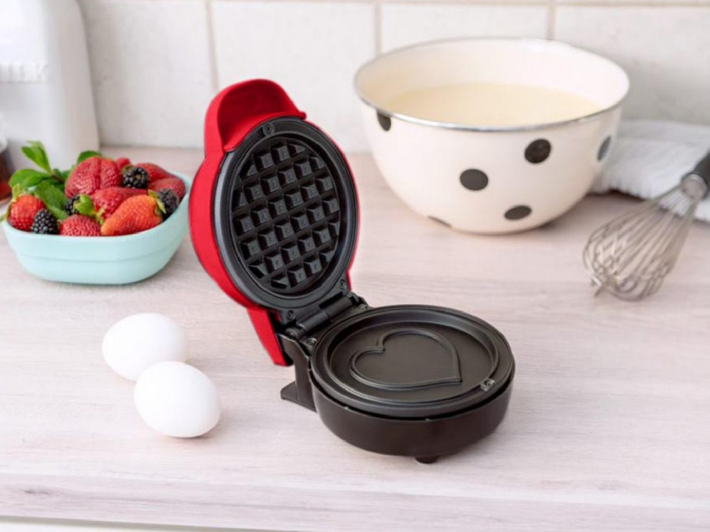 waffle maker on counter by cooking ingredients