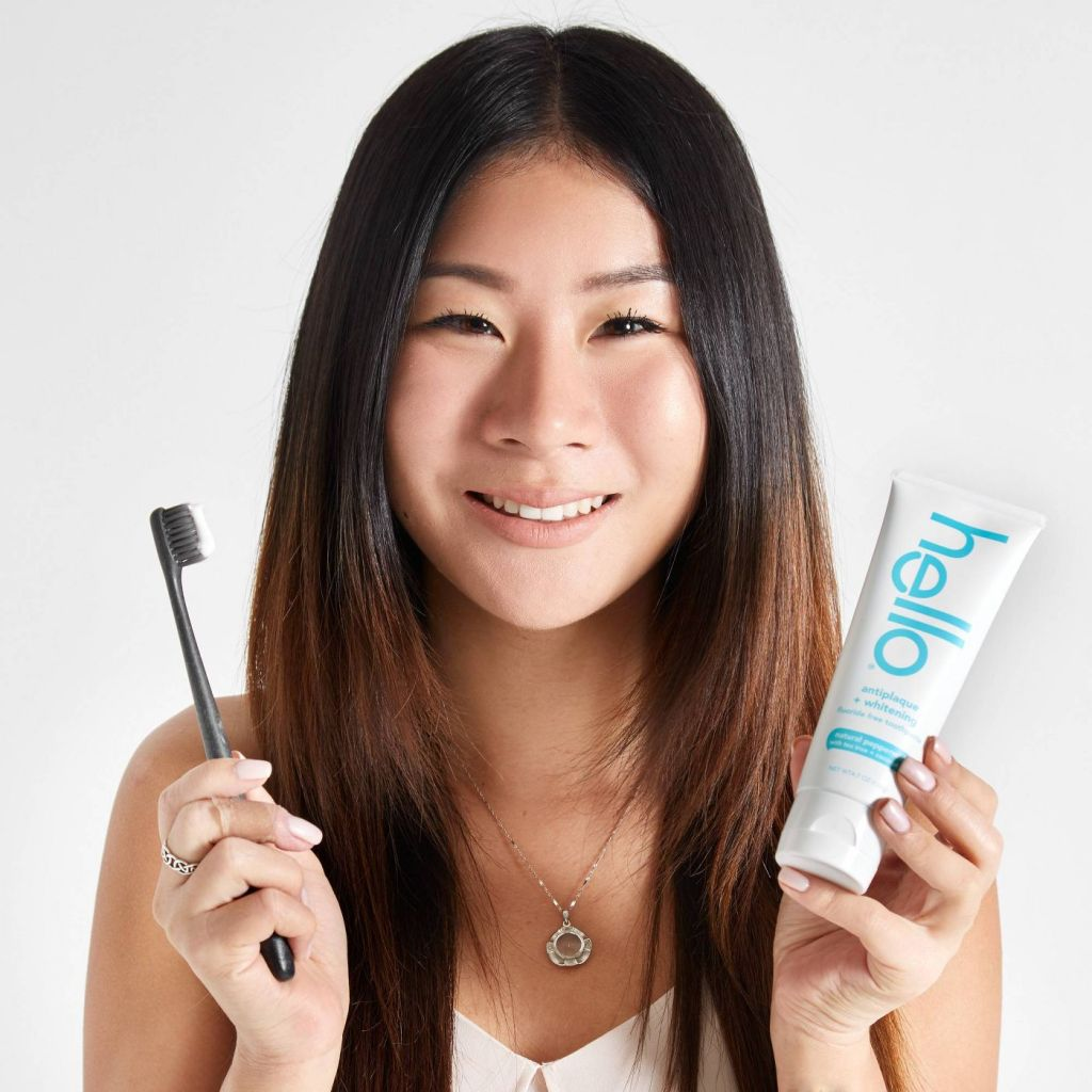 woman with Hello Flouride Free Toothpaste and toothbrush
