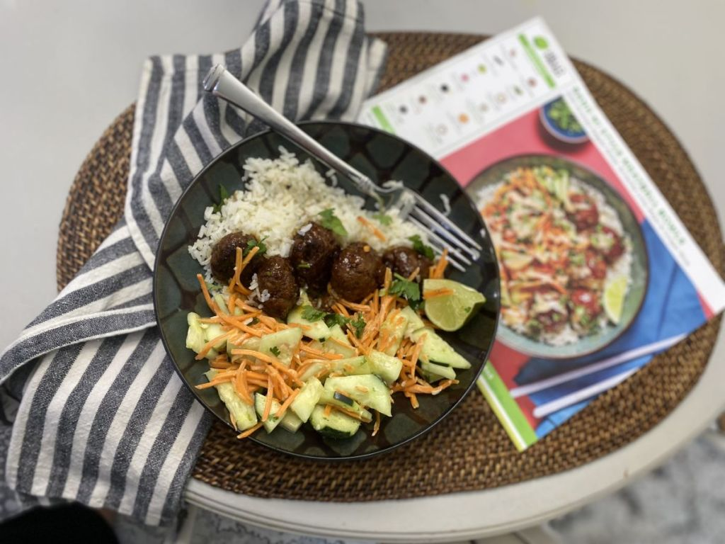 meal on a plate with a recipe next to it