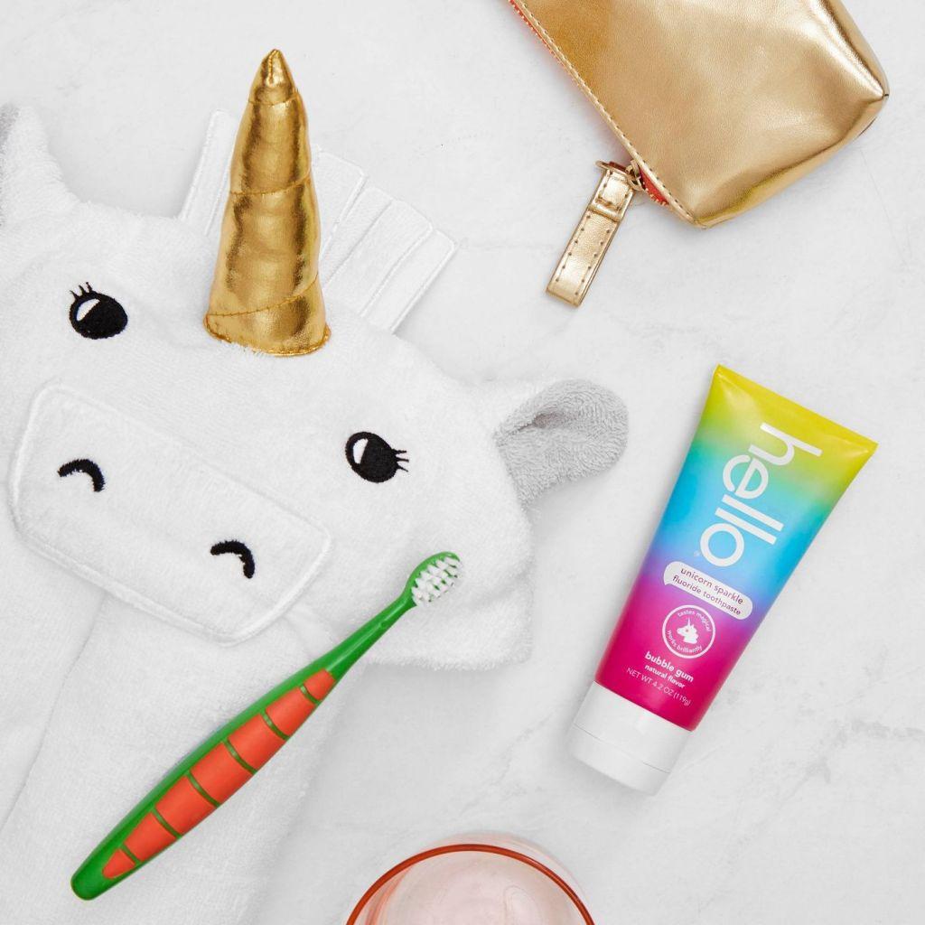 Hello Toothpaste next to unicorn towel