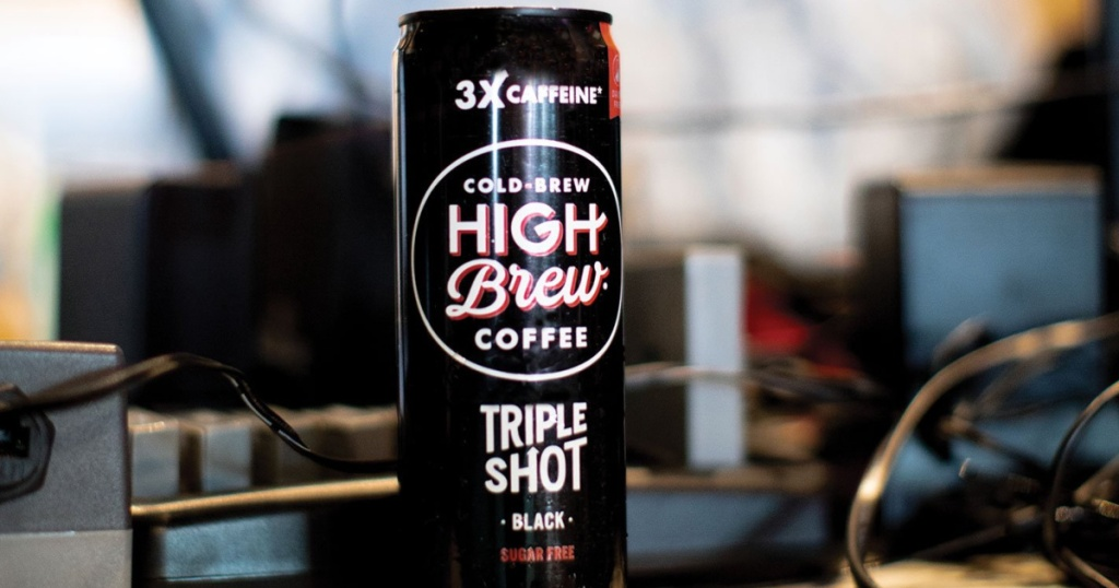 High Brew Coffee Triple Shot in front of stereo equipment