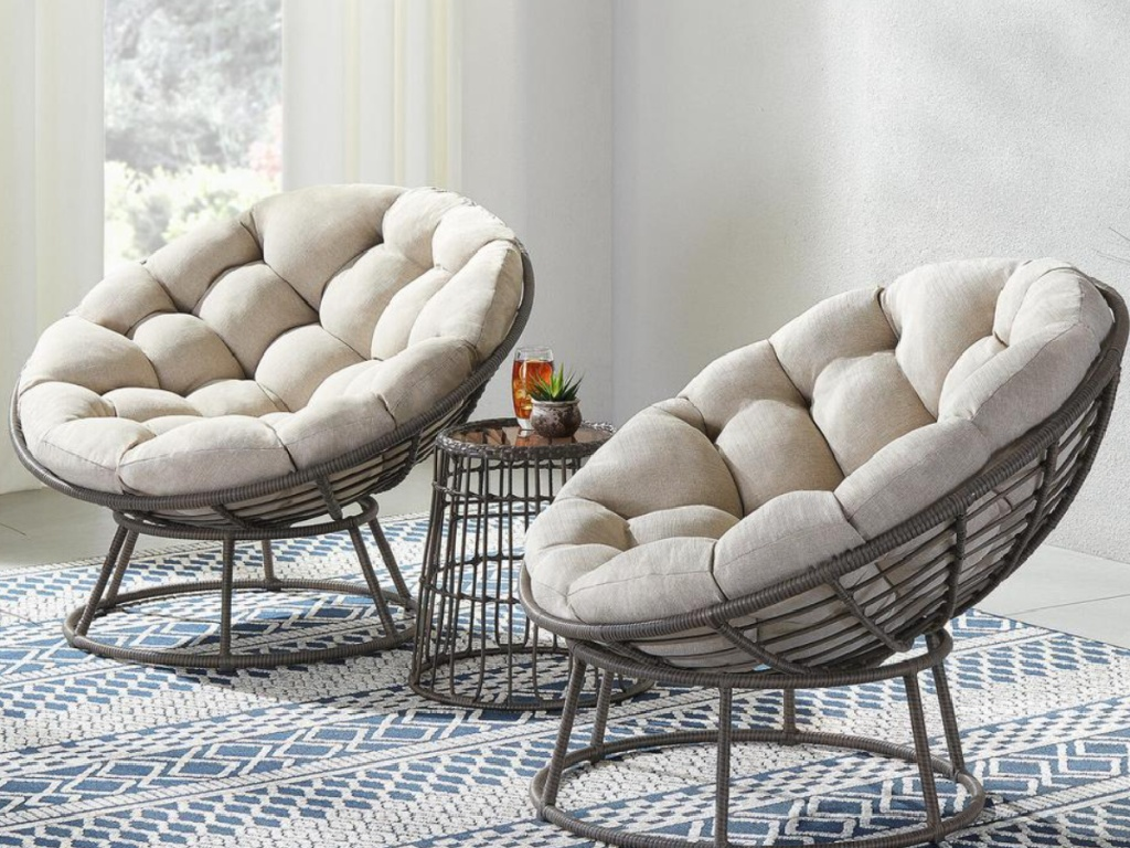 2 papasan chairs and a small table