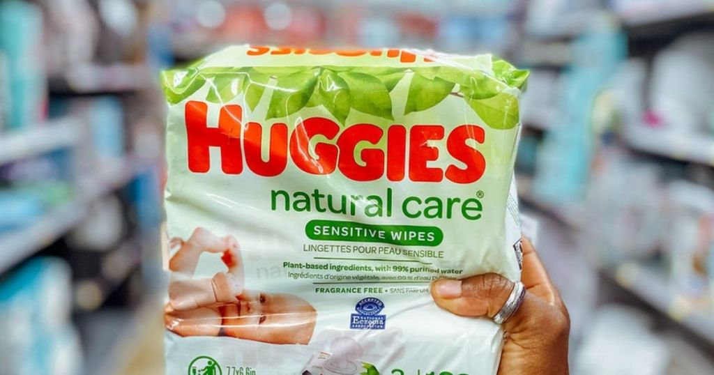 hand holding a package of Huggies Natural Care wipes