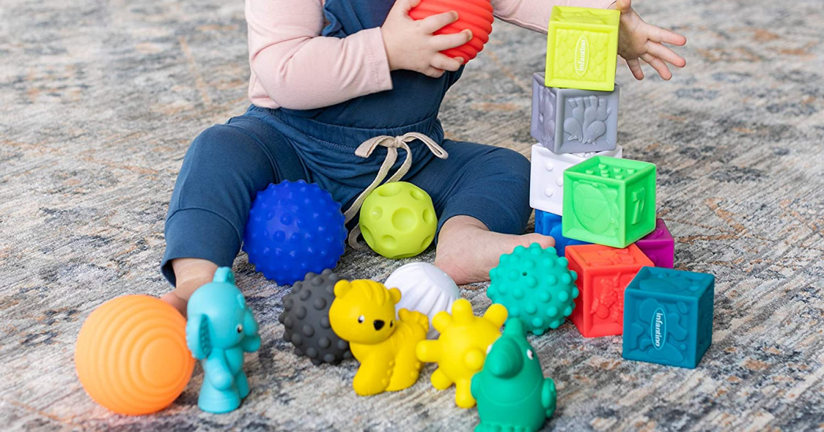 baby playing with colorful soft blocks