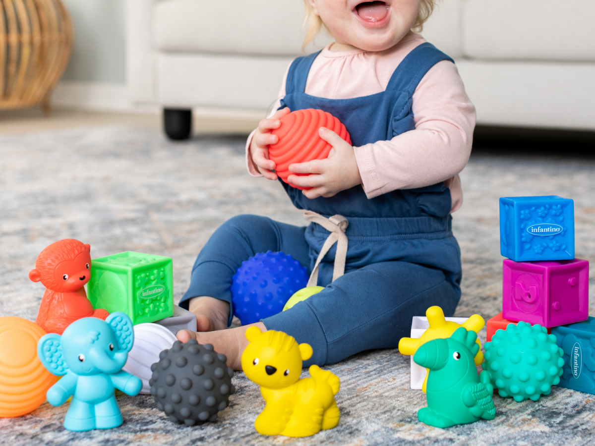 baby playing with soft blocks