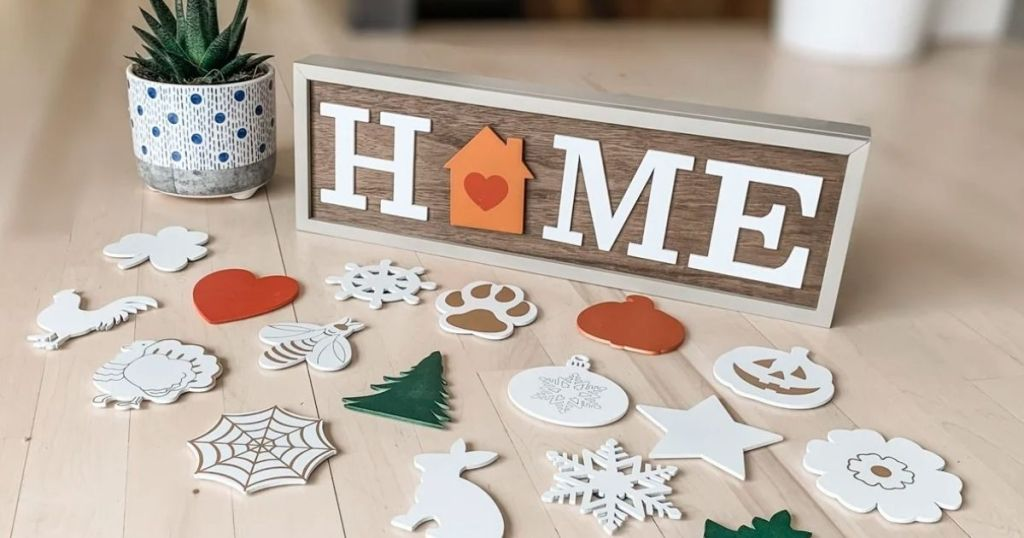 interchangeable wood HOME sign with pieces scattered around it