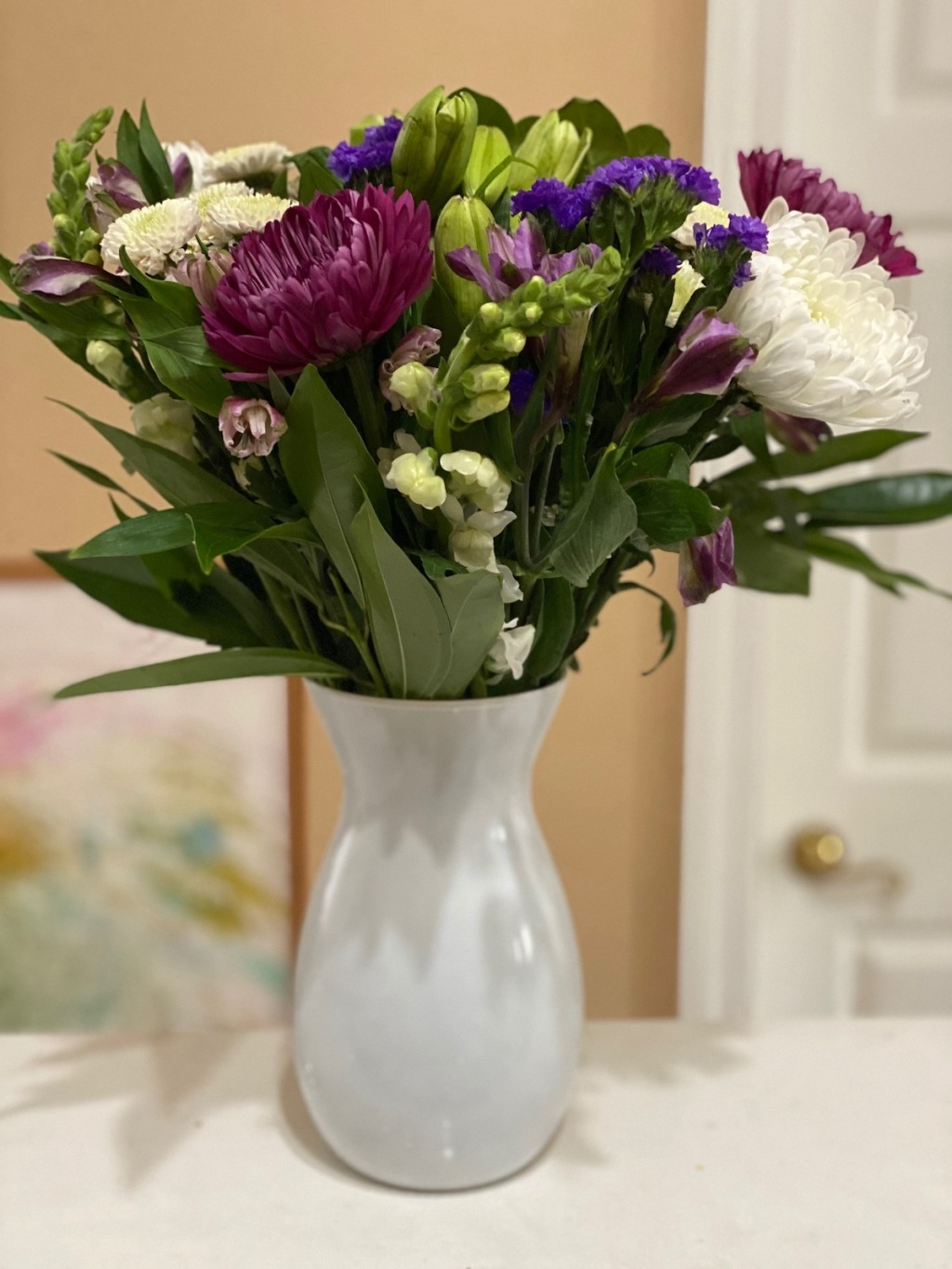 bouquet of flowers sitting in vase on counter