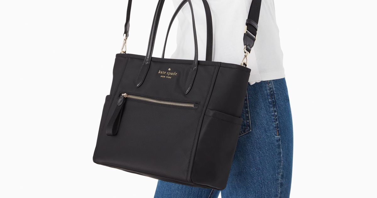 woman wearing black satchel
