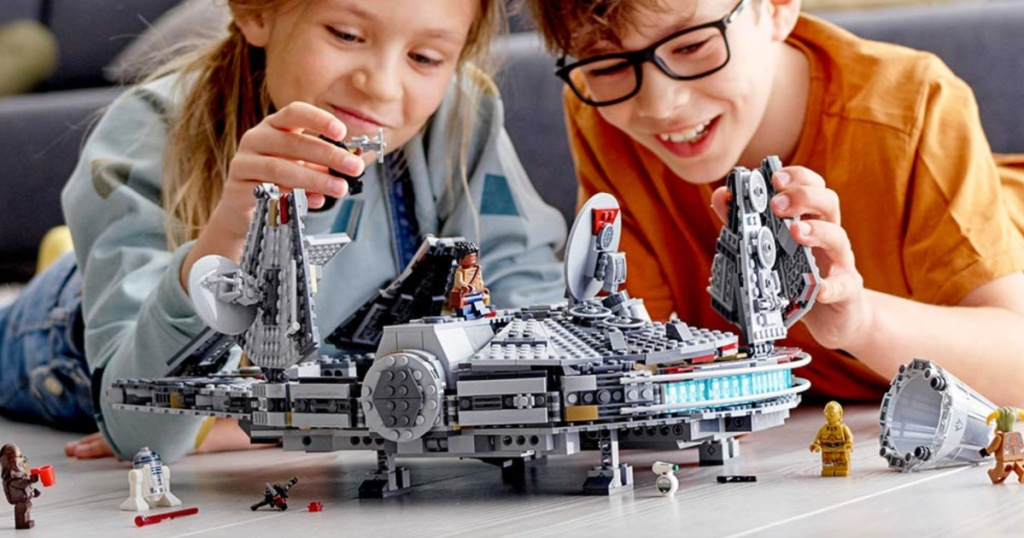 kids playing with LEGO millenium falcon