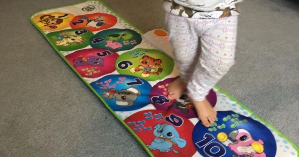 kid playing on a toy mat