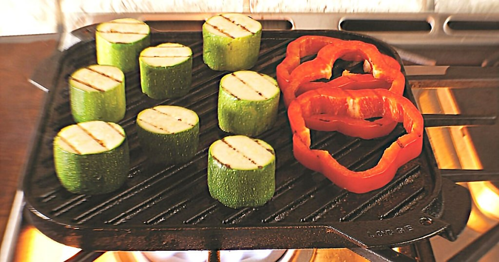 cast iron grill on stove with veggies