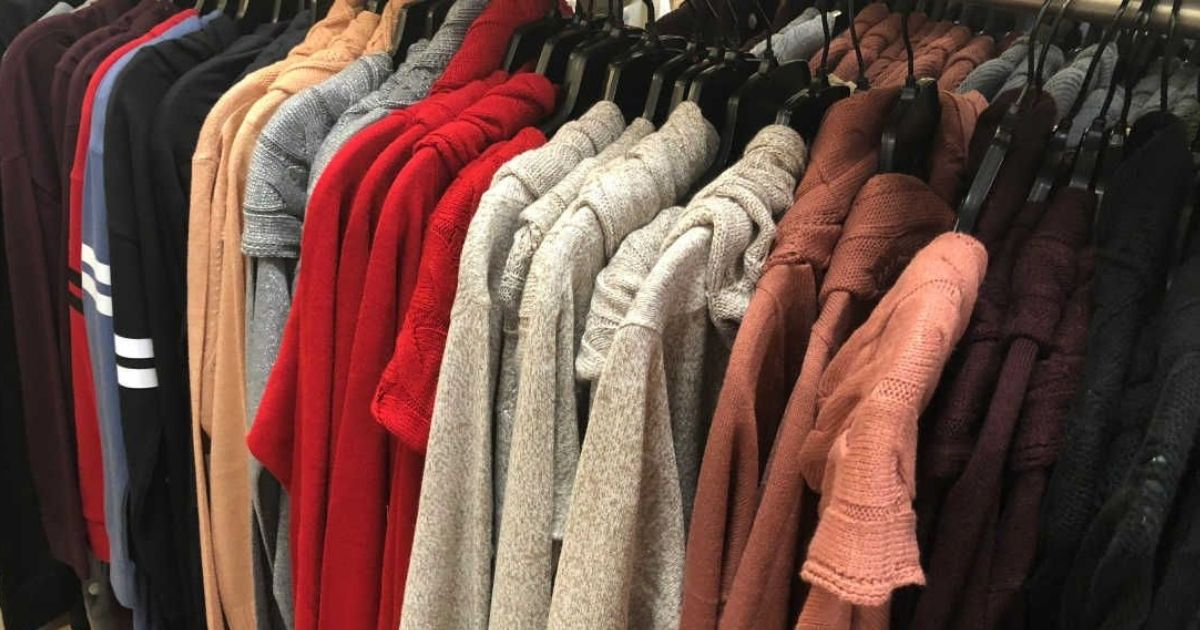 womens sweaters hanging in store