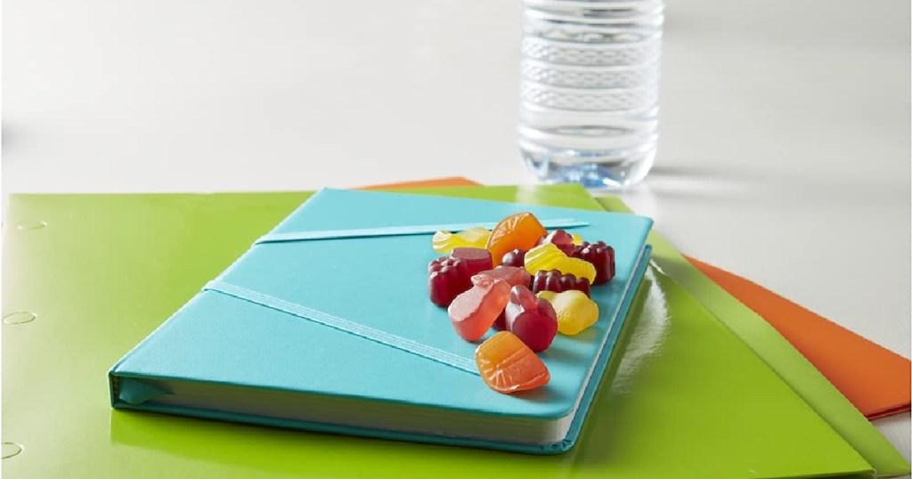 fruit shaped gummy snacks on a blue notebook